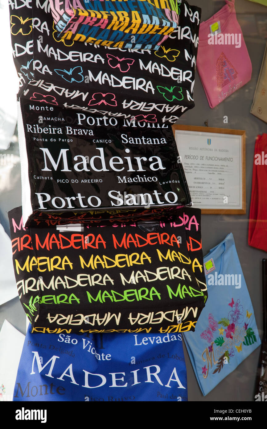 'Bags for Life' _ Souvenirs of Madeira hanging outside Tourist Shop, Funchal, Madeira - Stock Image
