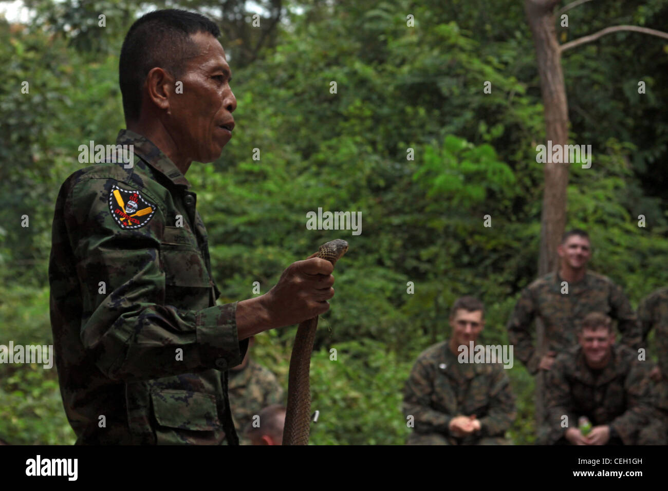 Royal Thai Marine Corps 2nd Lt  Pranom Yodrug instructs U S