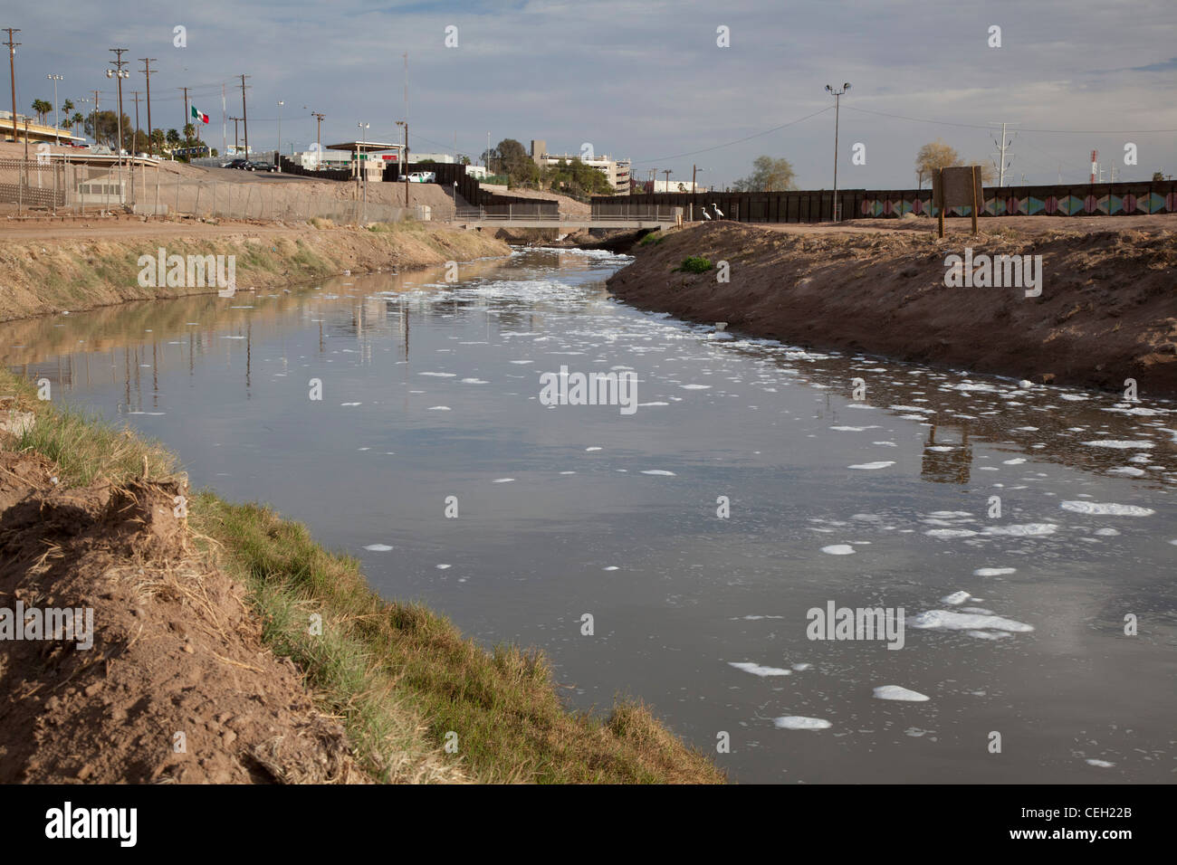 The heavily-polluted New River, as it enters the USA from Mexico - Stock Image