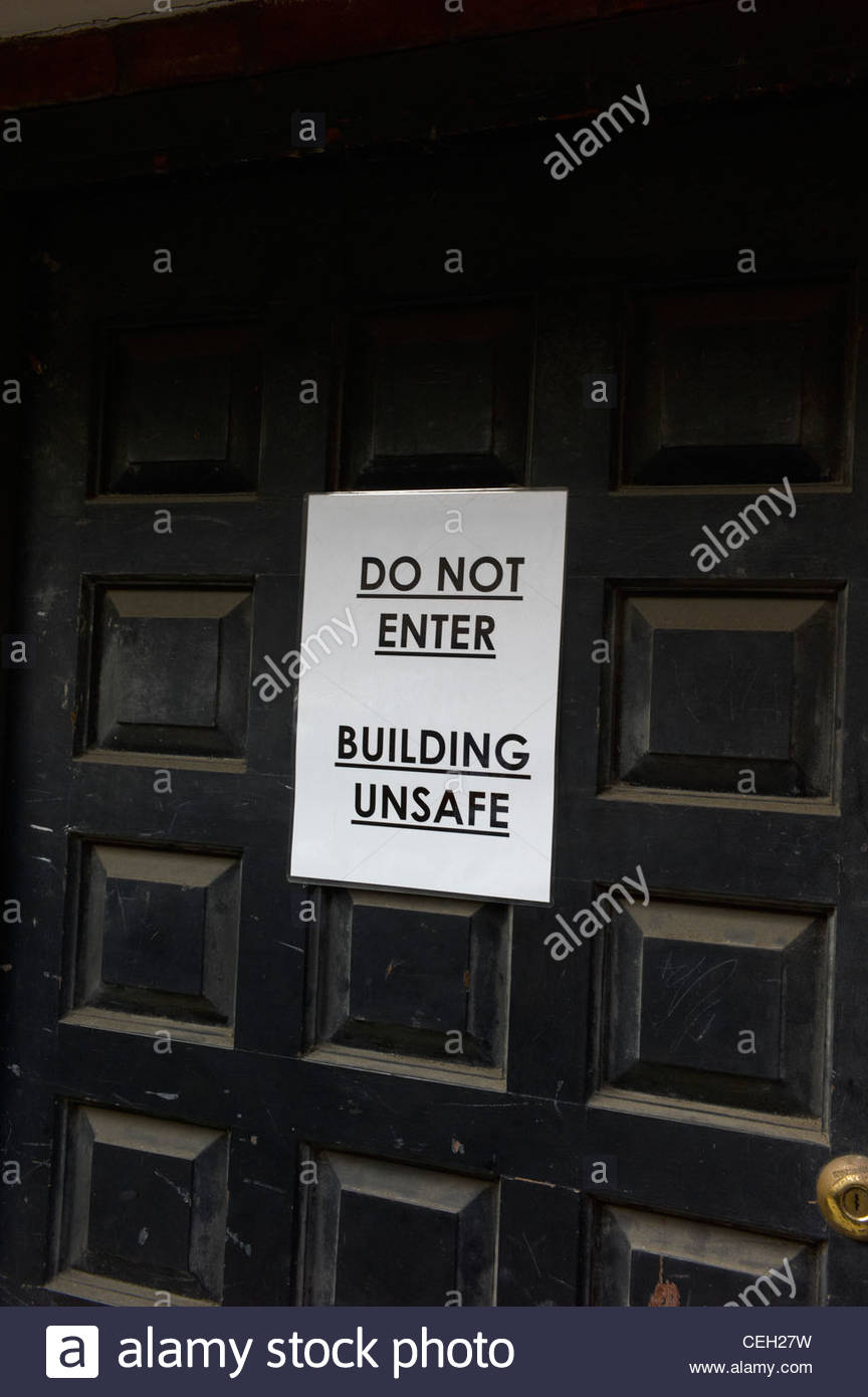 Building Unsafe sign on a door Do Not Enter - Stock Image