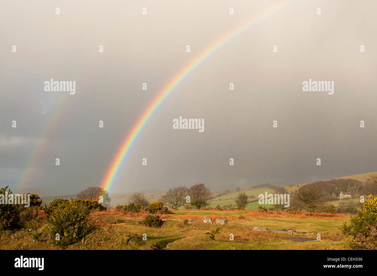 Primary and secondary rainbows captured over Dartmoor, Devon UK - Stock Image
