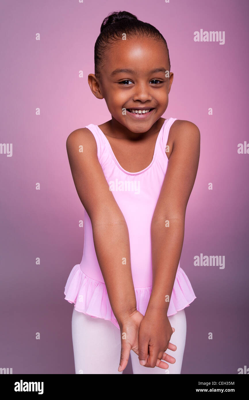 2c7cd400f9a5 Portrait of a cute little African American girl wearing a ballet ...