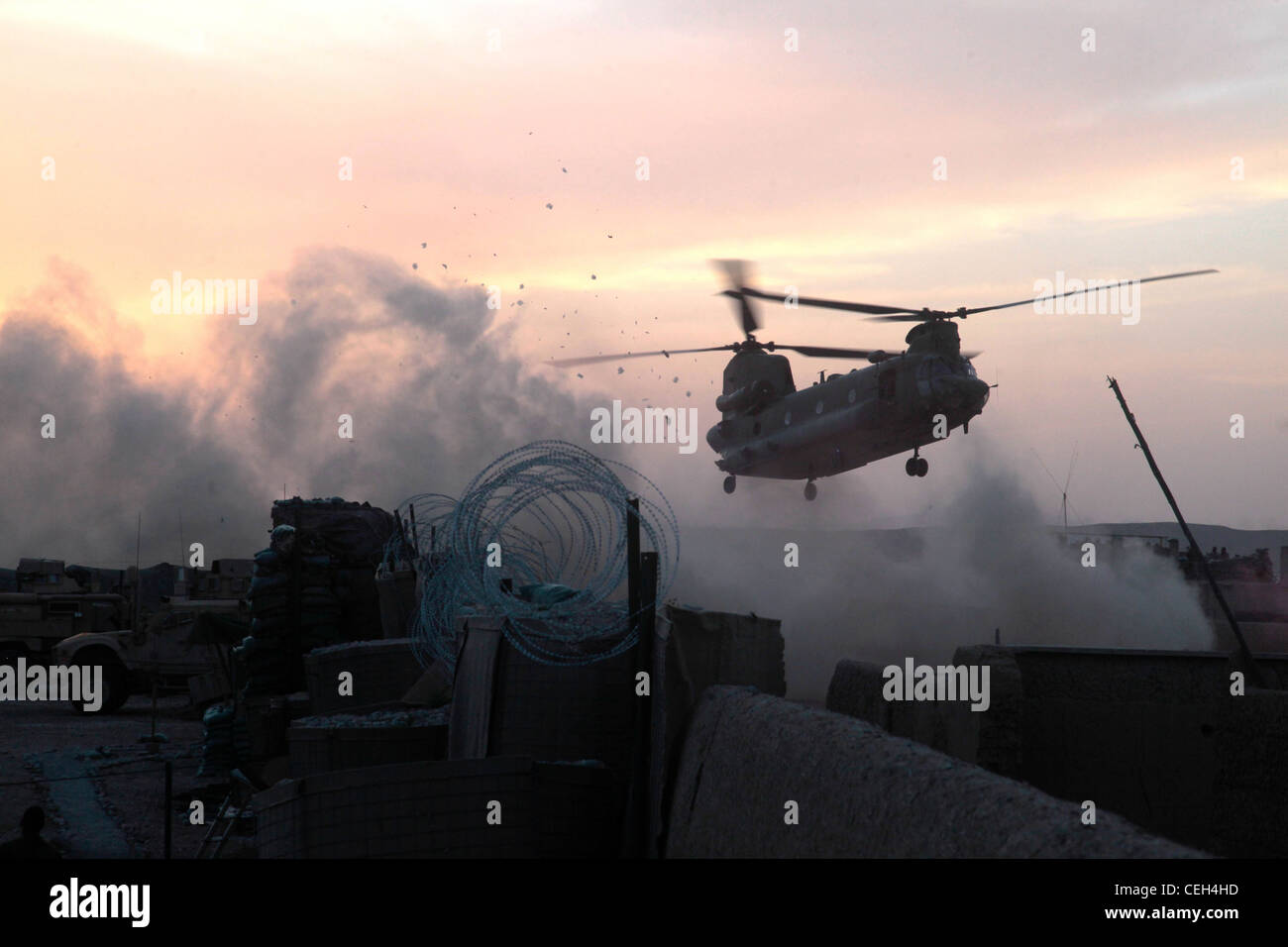 A British CH-47 helicopter lands at Patrol Base Wishtan to evacuate an Afghan National Civil Order Police soldier - Stock Image