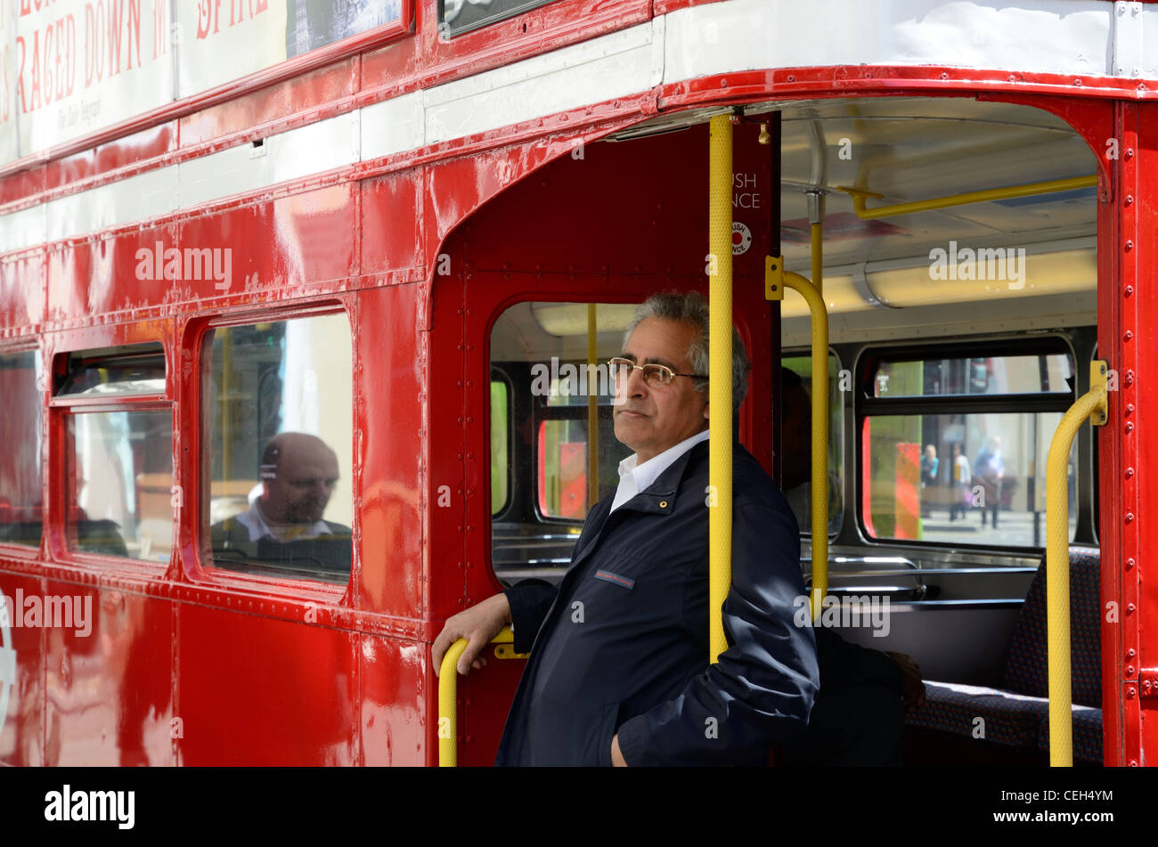 Bus Conductor on a Routemaster - Stock Image