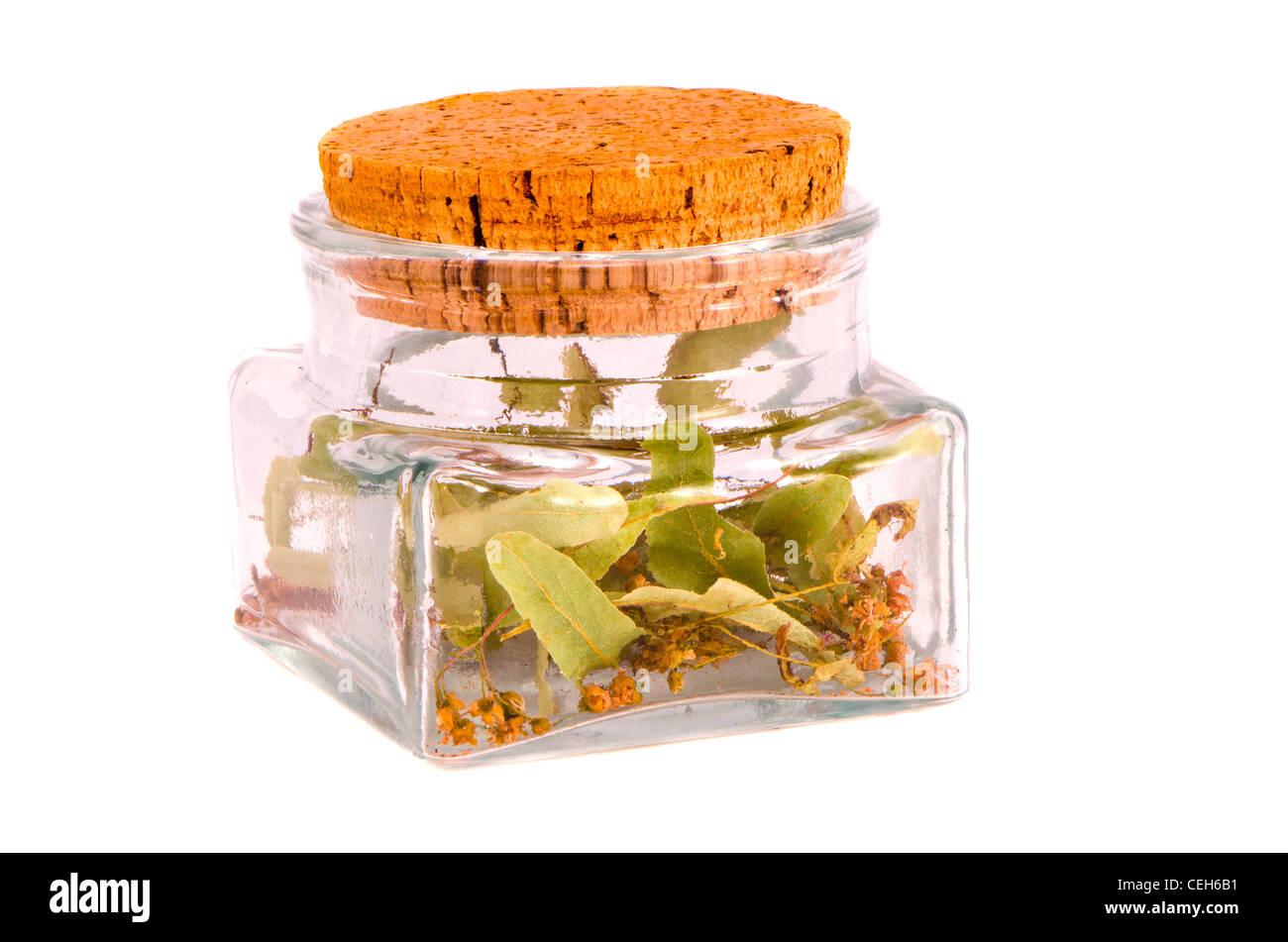 isolated on white glass jar with linden blossoms herbal tea - Stock Image