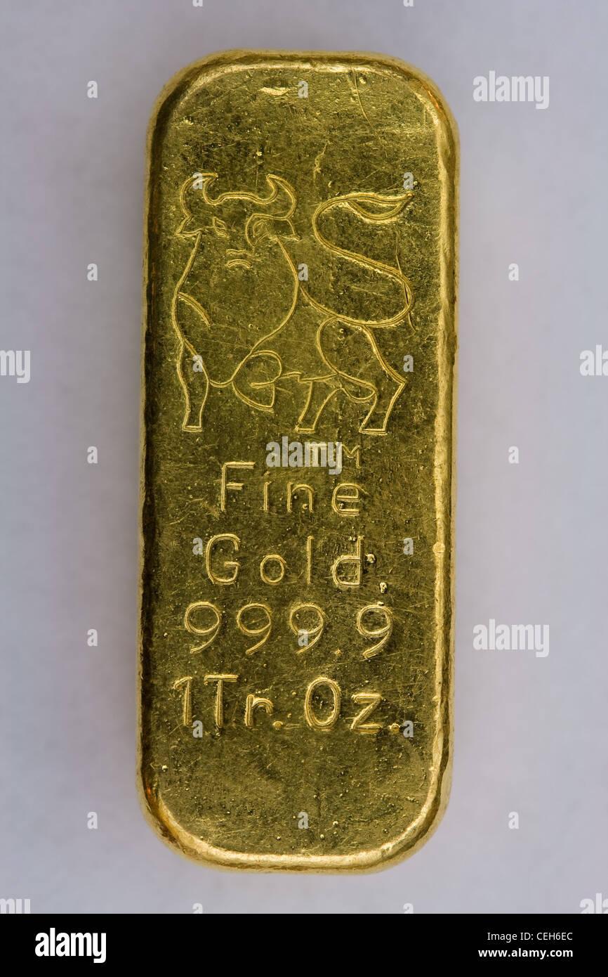 One Troy Ounce Gold Bullion Bar - Stock Image