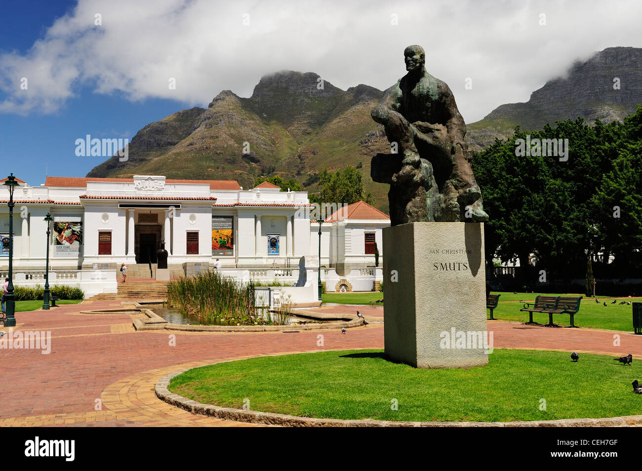 Statue of Jan Christian Smuts in Company's Garden with National Gallery in background, Cape Town, Western Cape, Stock Photo