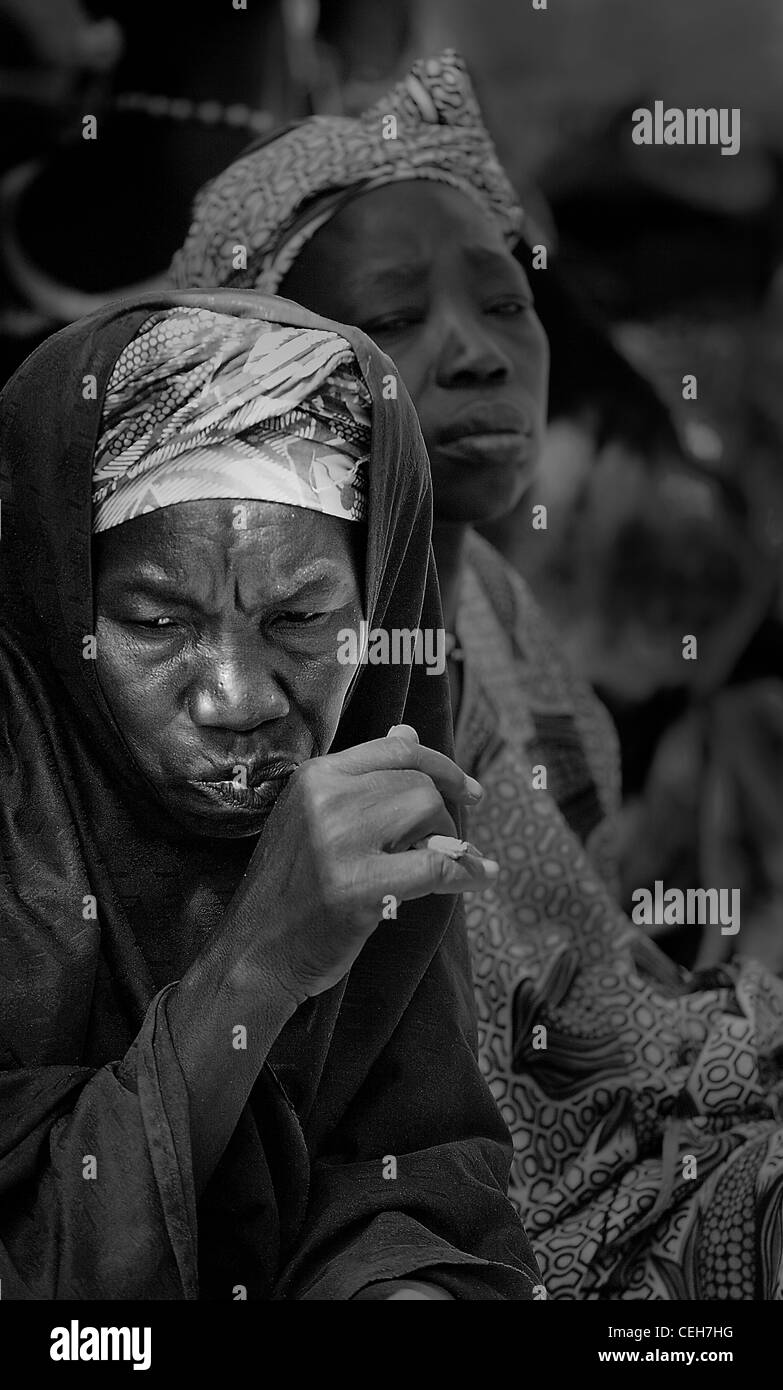 Gambian man/woman in a street market in Gambia,the photo is in colour. - Stock Image