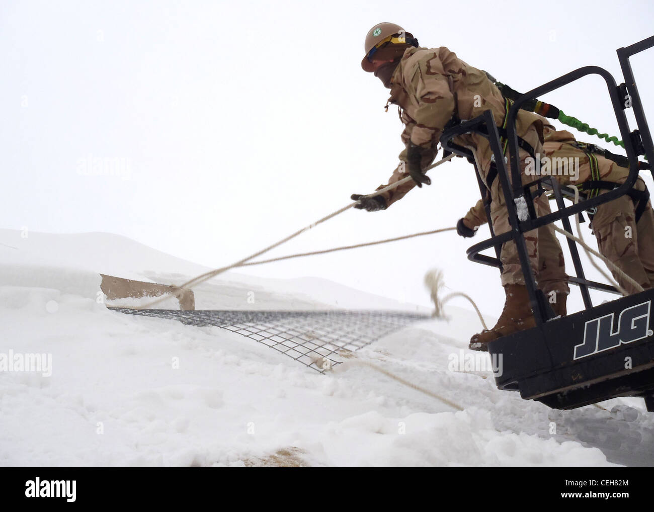 Seabees assigned to Detail Wolverine of Naval Mobile Construction Battalion 7 perform emergency snow removal from - Stock Image