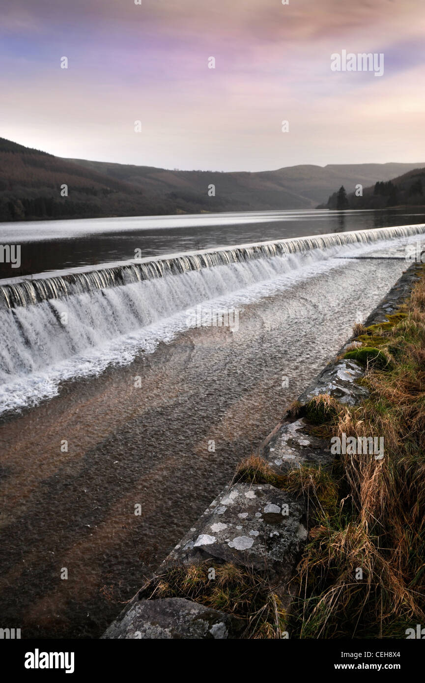 A weir at the Talybont Reservoir near Brecon in mid Wales UK - Stock Image