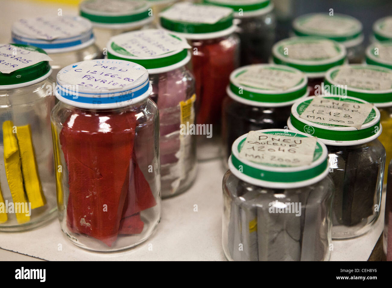 Assorted jars of colouring for tires at the Hutchinson tire factory - Stock Image