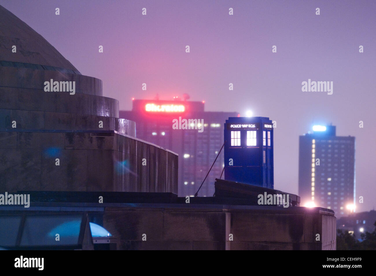 Hackers installed an illuminated 'Doctor Who'-style police call box ('TARDIS') on the roof of Building - Stock Image