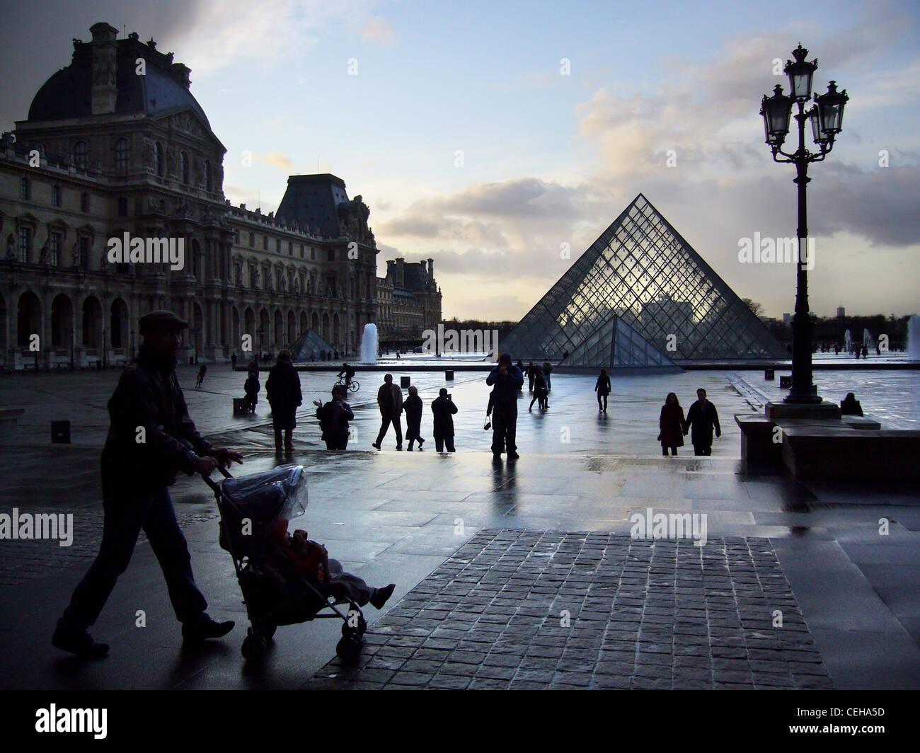 Silhouettes on a rainy day in Place du Carrousel du Louvre, Paris, France Stock Photo