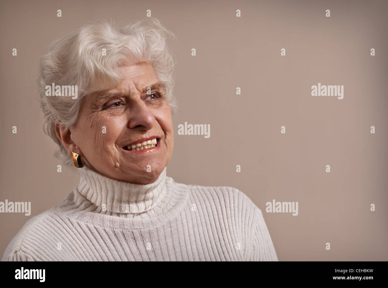 Senior lady portrait, smiling with copy space. - Stock Image