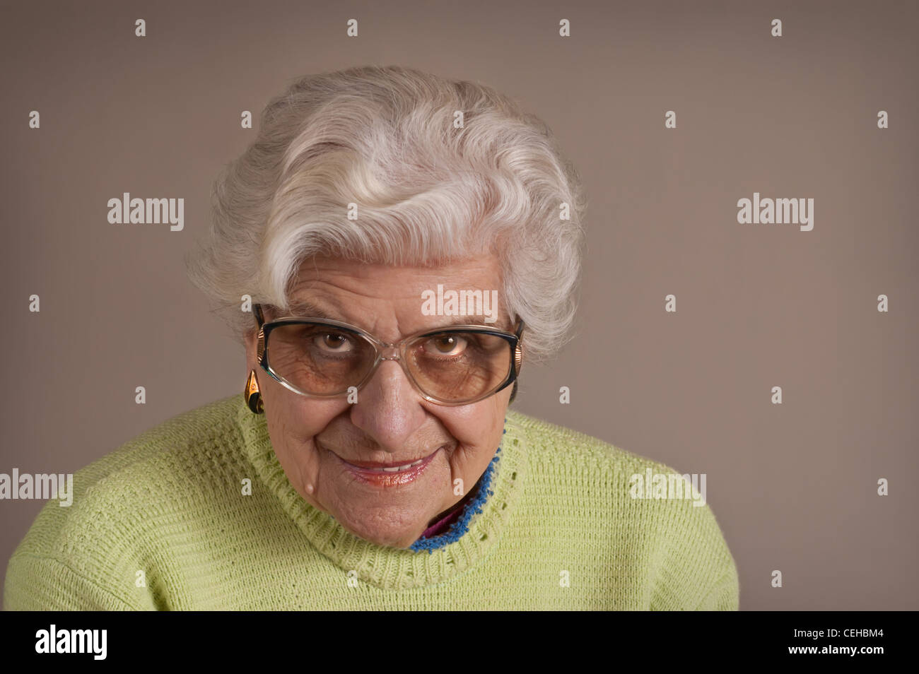 Senior lady portrait, smiling, glasses, with copy space. - Stock Image