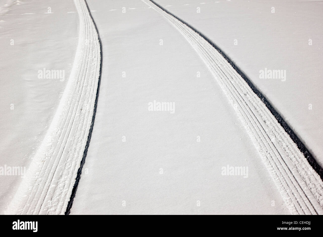 Fresh tire tracks on a snow covered mountain road near Monarch Pass, Chaffee County, Colorado, USA - Stock Image