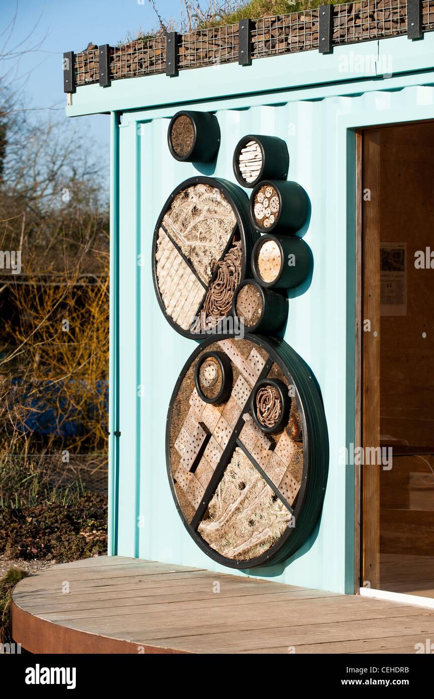 Insect habitats in the RBC Rain Garden at Slimbridge WWT in Gloucestershire - Stock Image