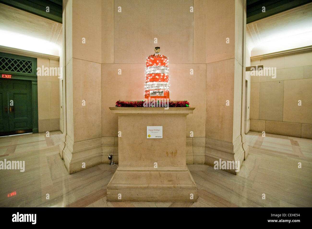 To celebrate the coming holidays, MIT facilities installed two Christmas-light-wrapped orange construction barrels - Stock Image