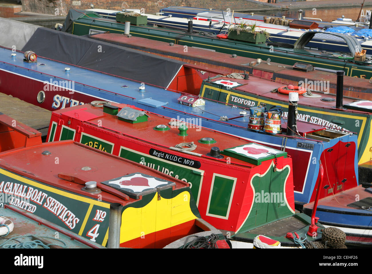 Selection of narrow boats moored up in birminham city centre on the birmingham and worcester canal, feb 2012. - Stock Image