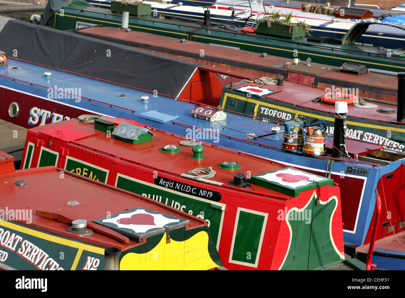 Selection of narrow boats moored up in birmingham city centre on the birmingham and worcester canal, feb 2012. - Stock Image
