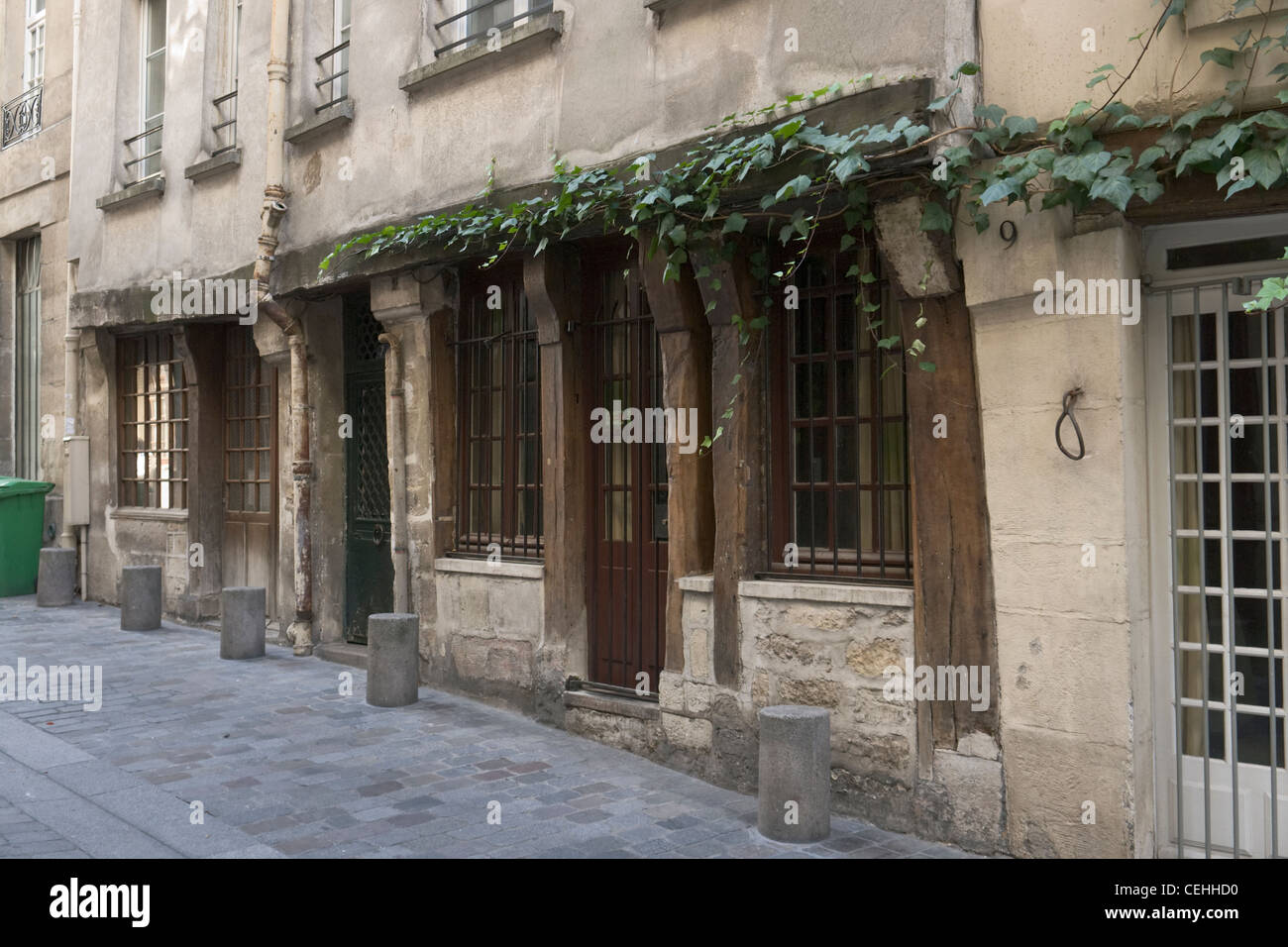 Old building with wooden beams and columns, Rue de Lanneau, Paris, France Stock Photo