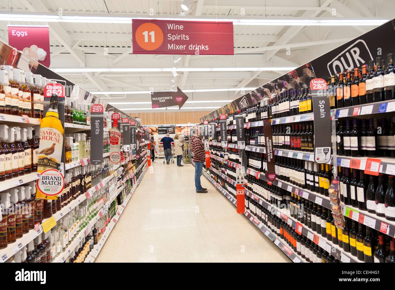 Alcoholic drinks aisle in Sainsbury's supermarket, England, UK - Stock Image