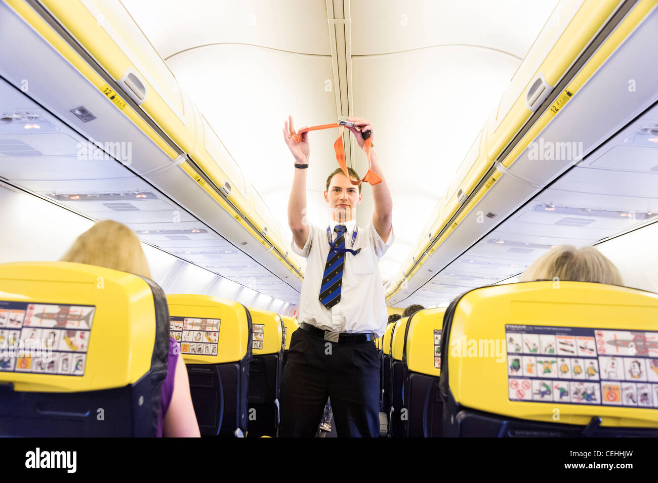 Preflight safety demonstration on board Ryanair plane, England, UK - Stock Image
