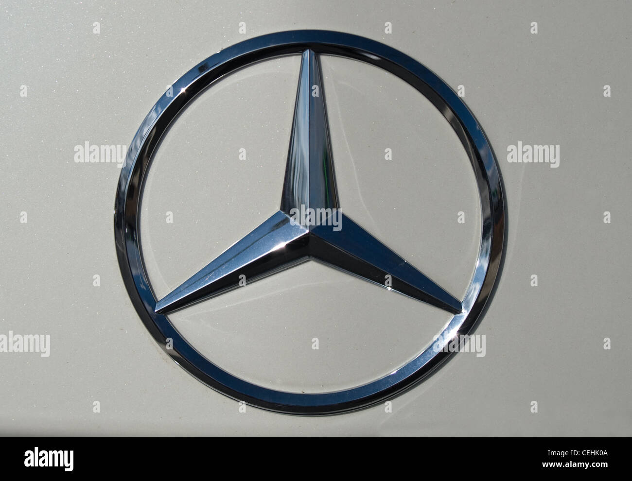 Mercedes Benz Symbol Logo On The Front Of The Car Stock Photo