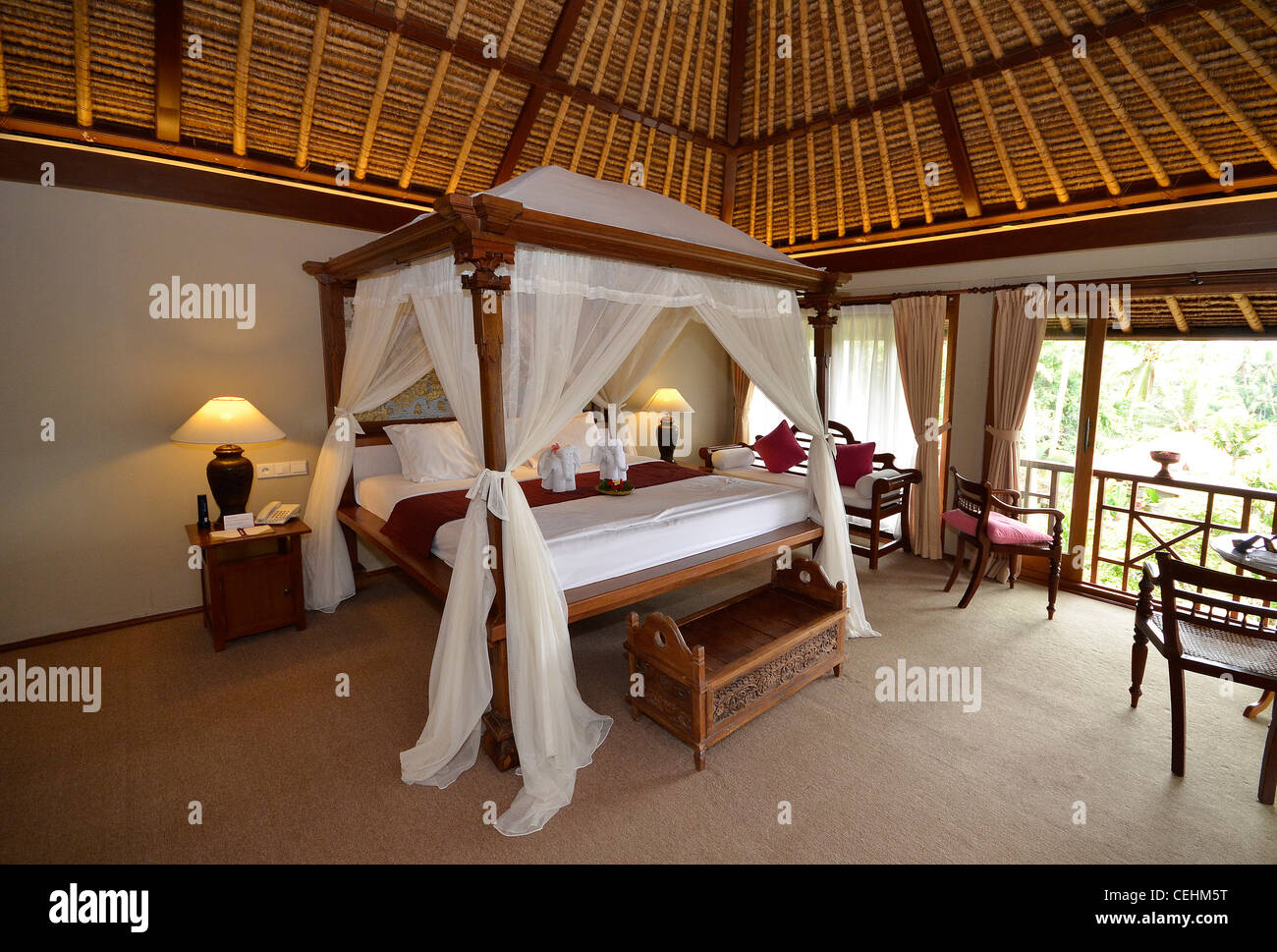 Bali Hotel Spa Bedroom With Four Poster Bed And Mosquito Nets Stock Photo Alamy