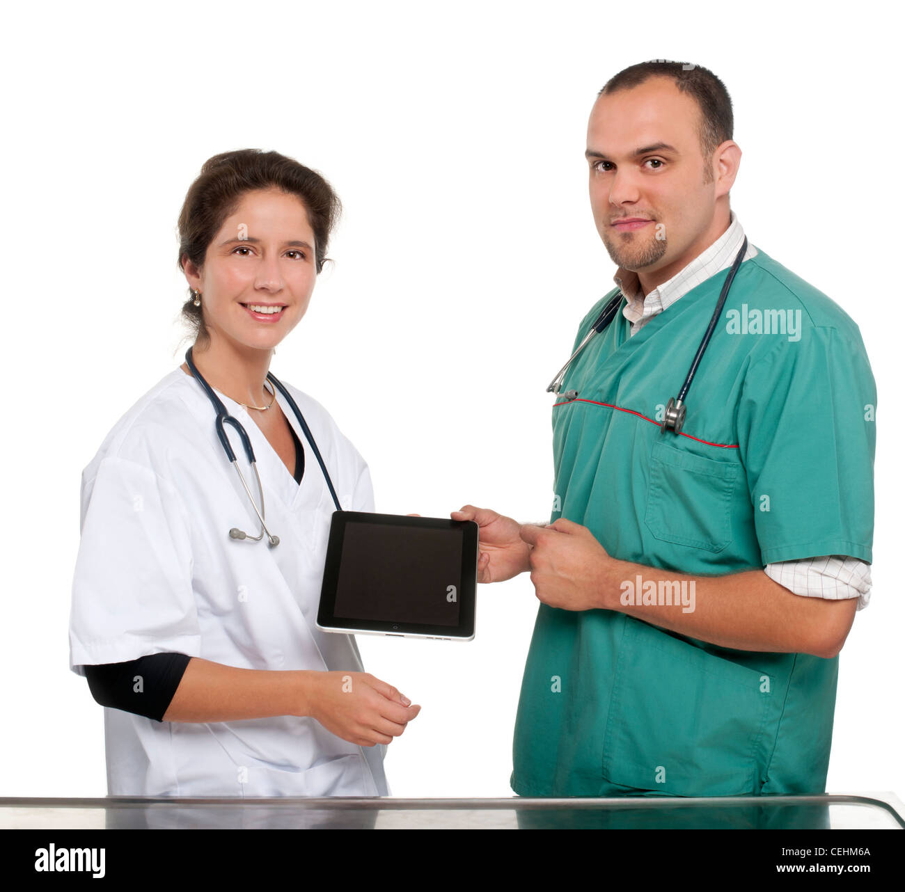 Vets holding a tablet in front of white background - Stock Image