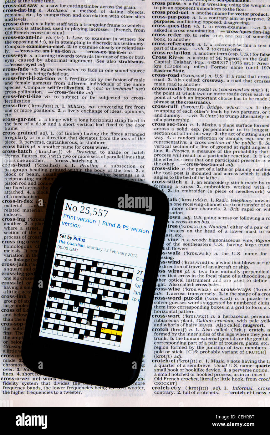 An online crossword puzzle displayed on a smartphone laying on a