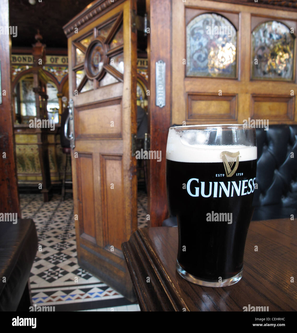 In the crown saloon bar Belfast with a pint of Guiness Stock Photo