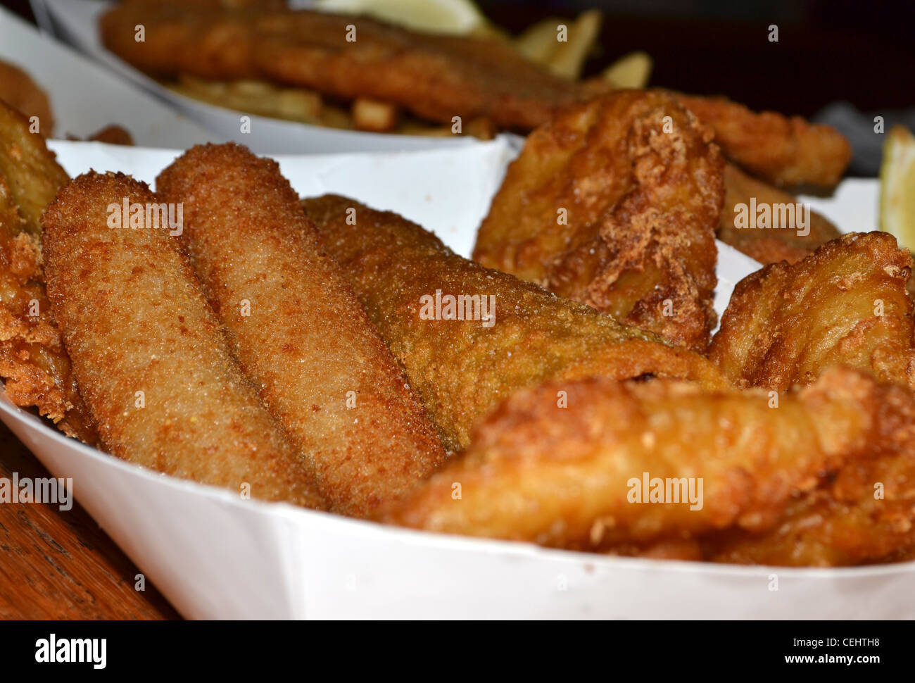 fish and chips, calamari, Chiko Roll, potato scallop, lemon fried seafood - Stock Image