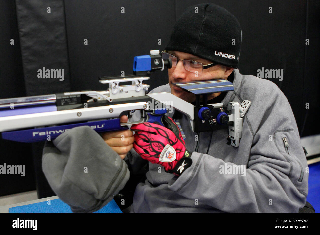 Marine Corps veteran team member Kevin Dewitt of Lexington, Ky., takes aim during air rifle practice at the Marine - Stock Image