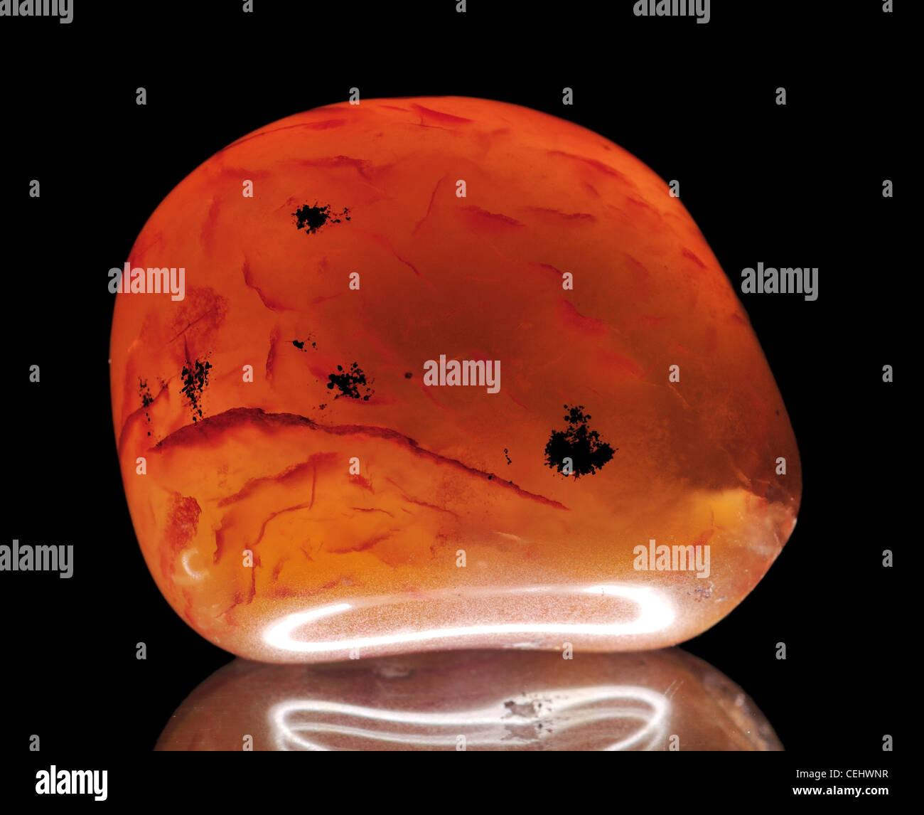 Polished Carnelian tumblestone - Stock Image