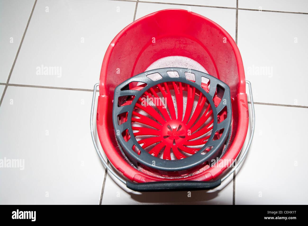Red Plastic kitchen floor mop bucket top view - Stock Image