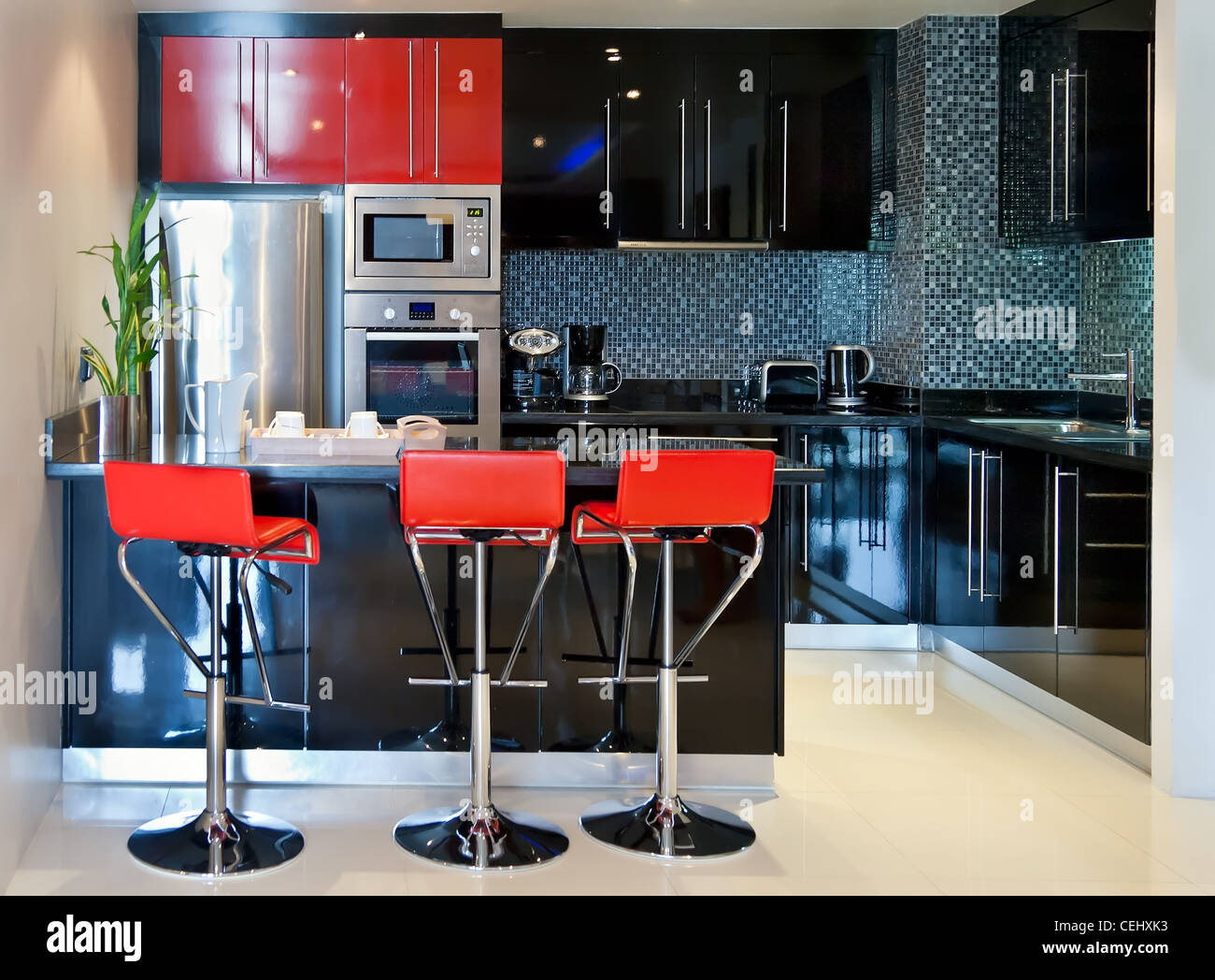 The kitchen chairs with red and black furniture Stock Photo ...