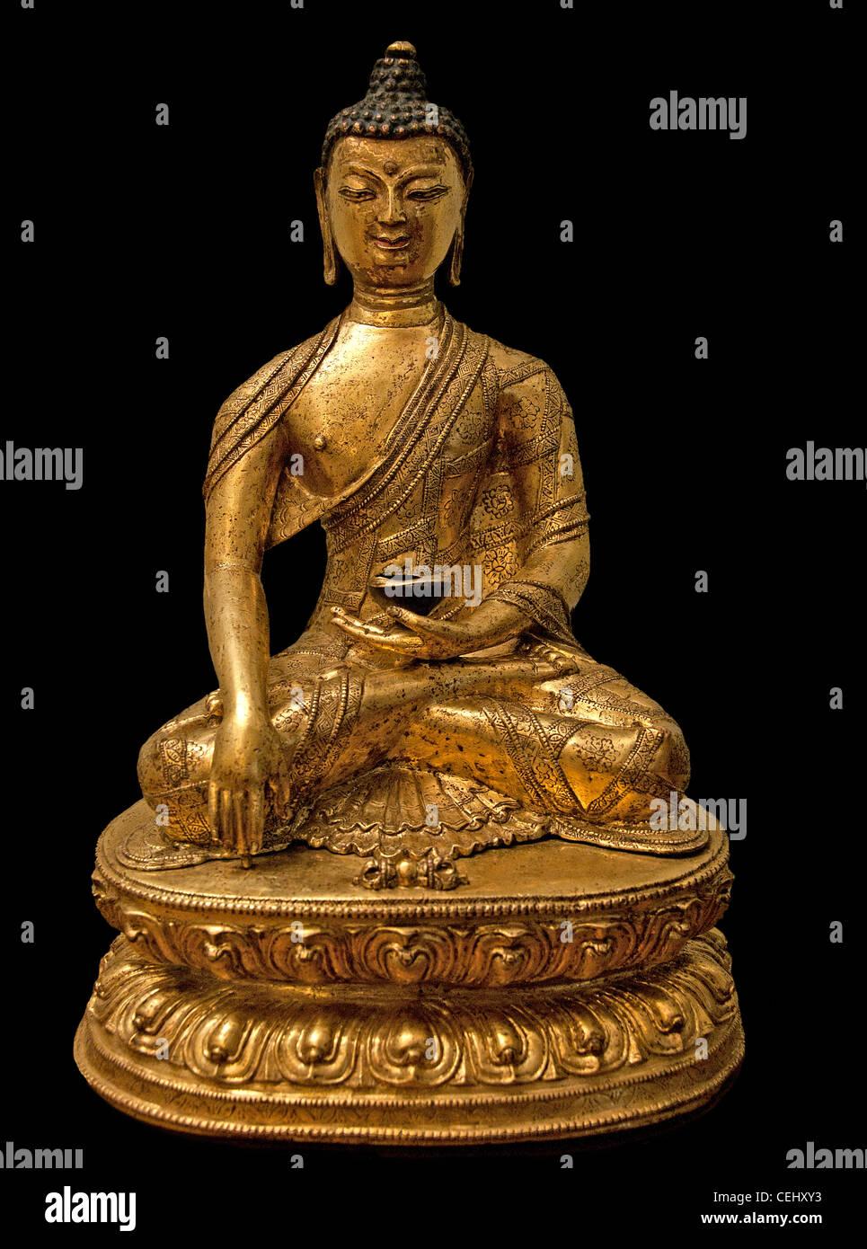 The Buddha Sakyamuni 15 - 16 Century Tibet Tibetan gilded copper - Stock Image