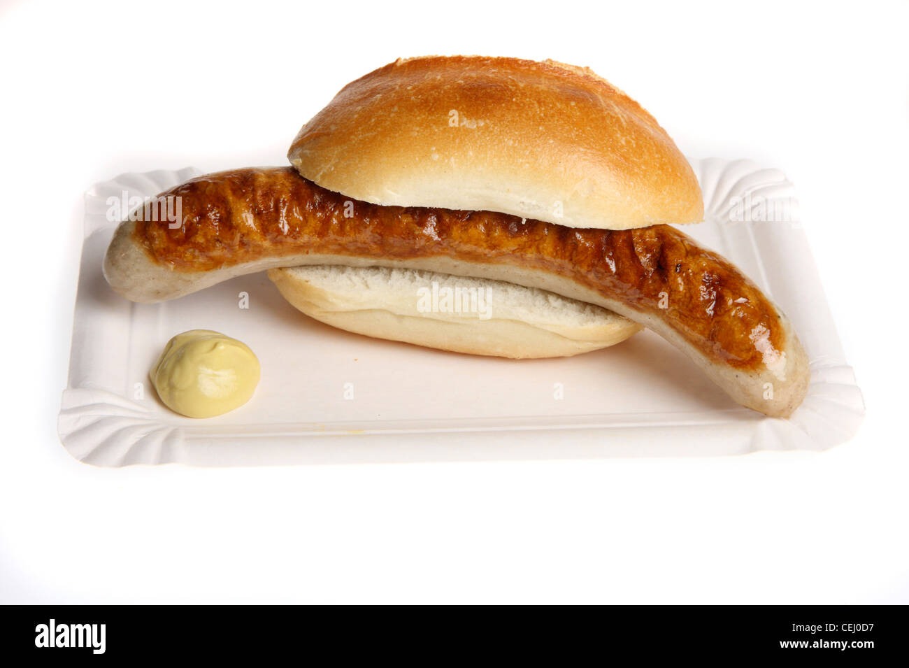 Nutrition, fast food. Bratwurst, meat sausage with a bread roll, mustard. Stock Photo