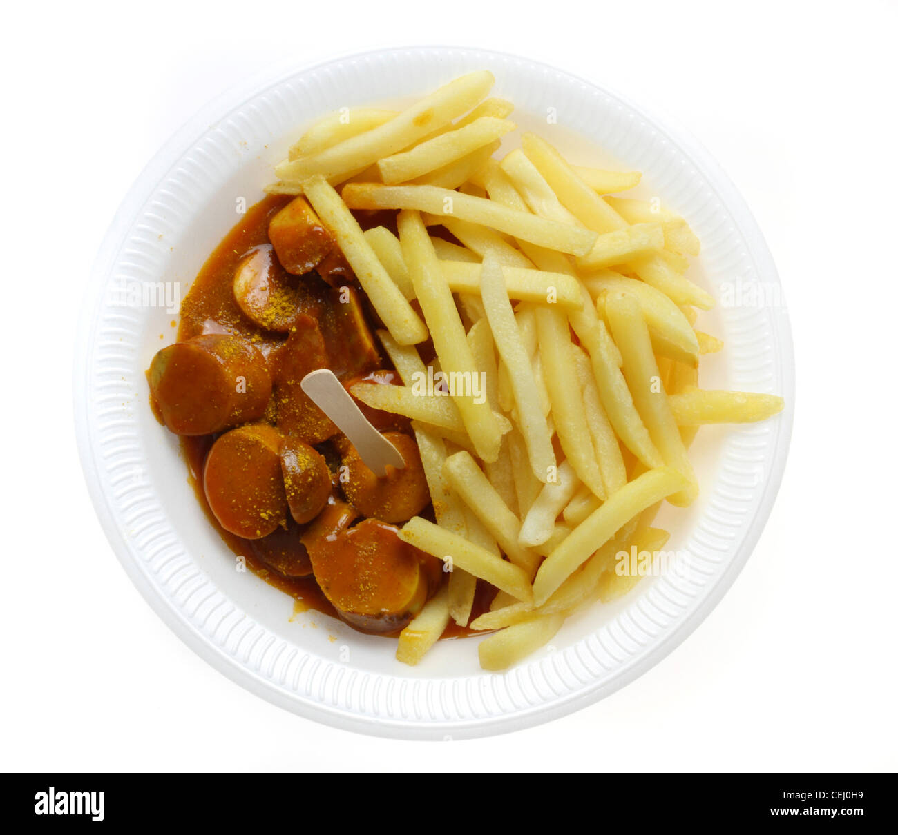 Nutrition, fast food. French fries with a  curry wurst, a Bratwurst style sausage with a spicy curry and tomato - Stock Image