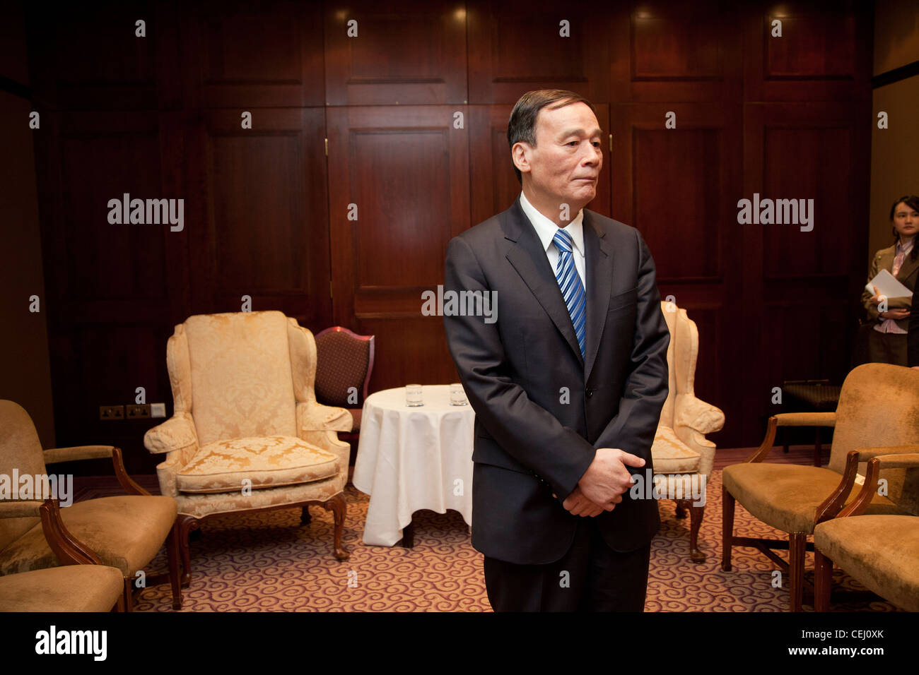 China's Vice Premier Wang Qishan waits to meet Scotland's First Minister, Alex Salmond ahead of talks. Sheraton - Stock Image