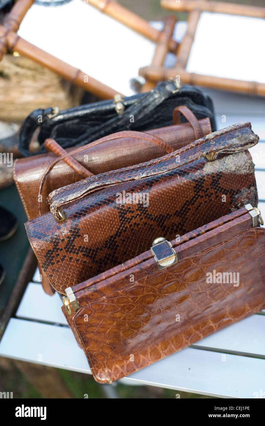 Animal skin handbags, Ardingly Antiques Fair, West Sussex, England, UK - Stock Image