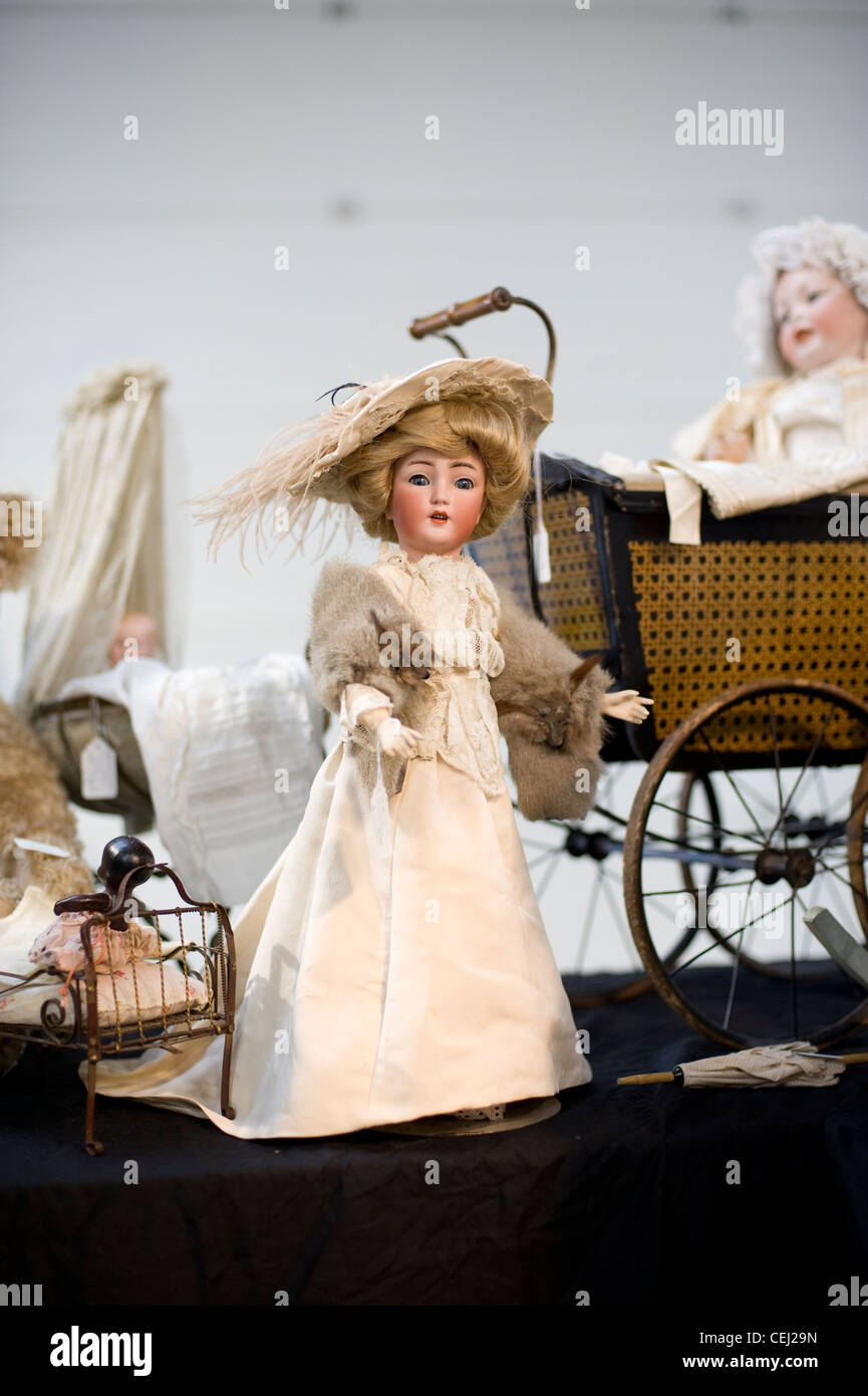 Antique doll, Ardingly antiques fair, West Sussex, England, UK - Stock Image