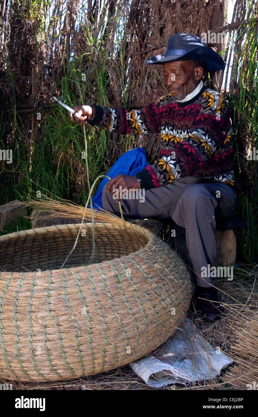 Man weaving a basket,Basotho Cultural Village,Qwa Qwa,Eastern Free State Province Stock Photo