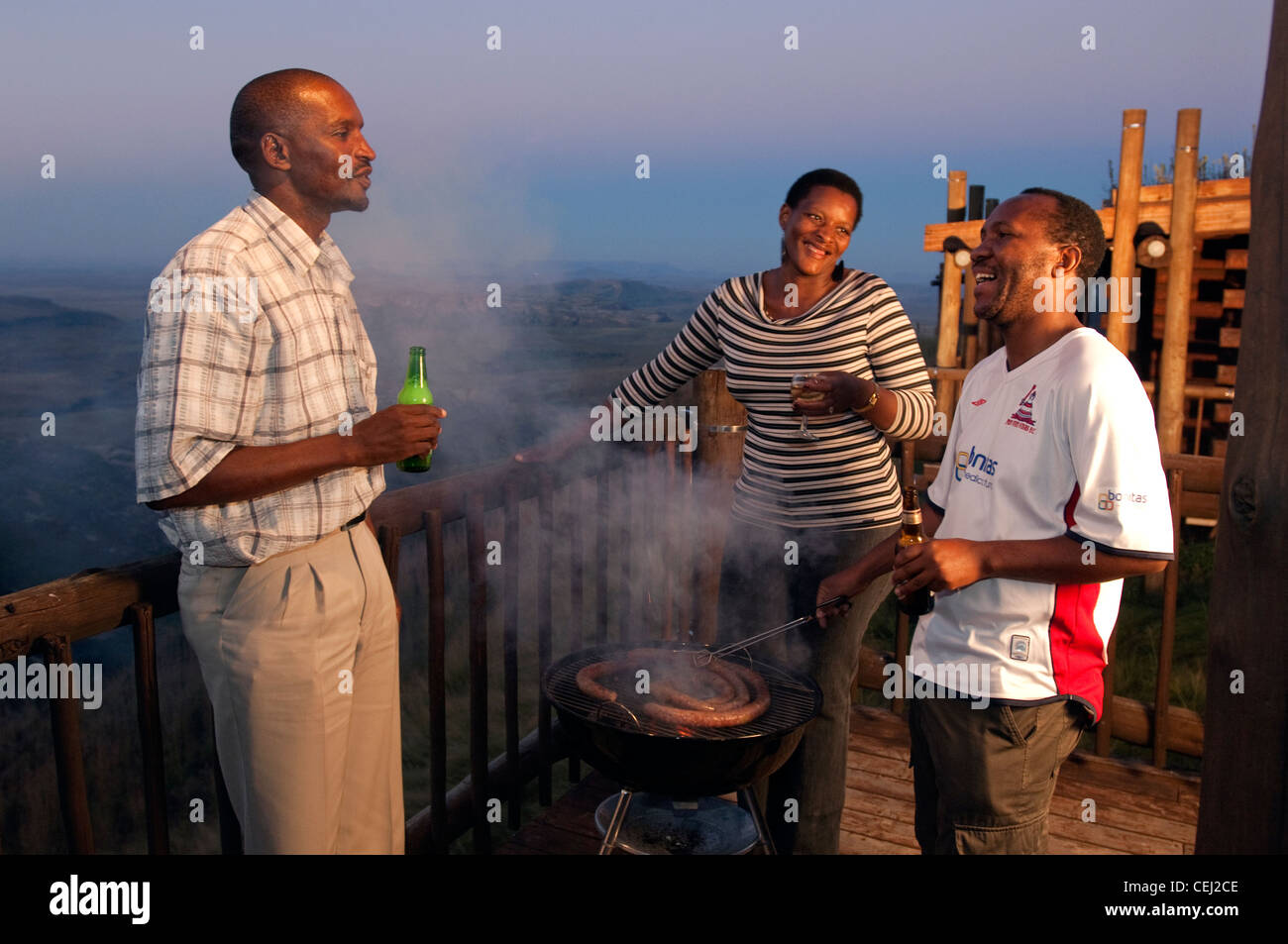 Guests standing around a Braai,Highlands Mountain Retreat,Golden Gate,Eastern Free State Province - Stock Image