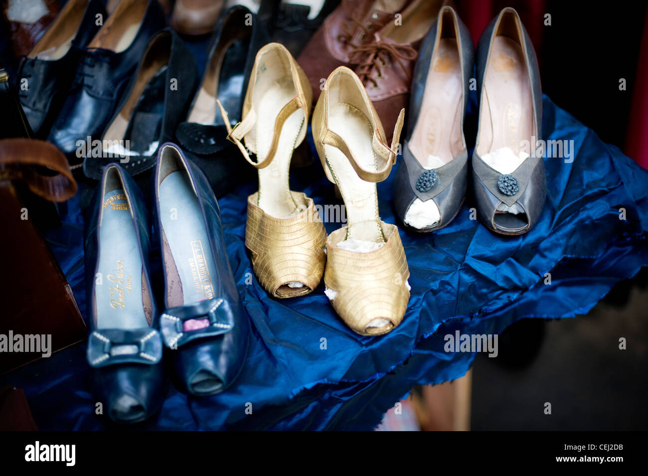 Vintage high heeled shoes, Ardingly antiques fair, West Sussex, England, UK - Stock Image