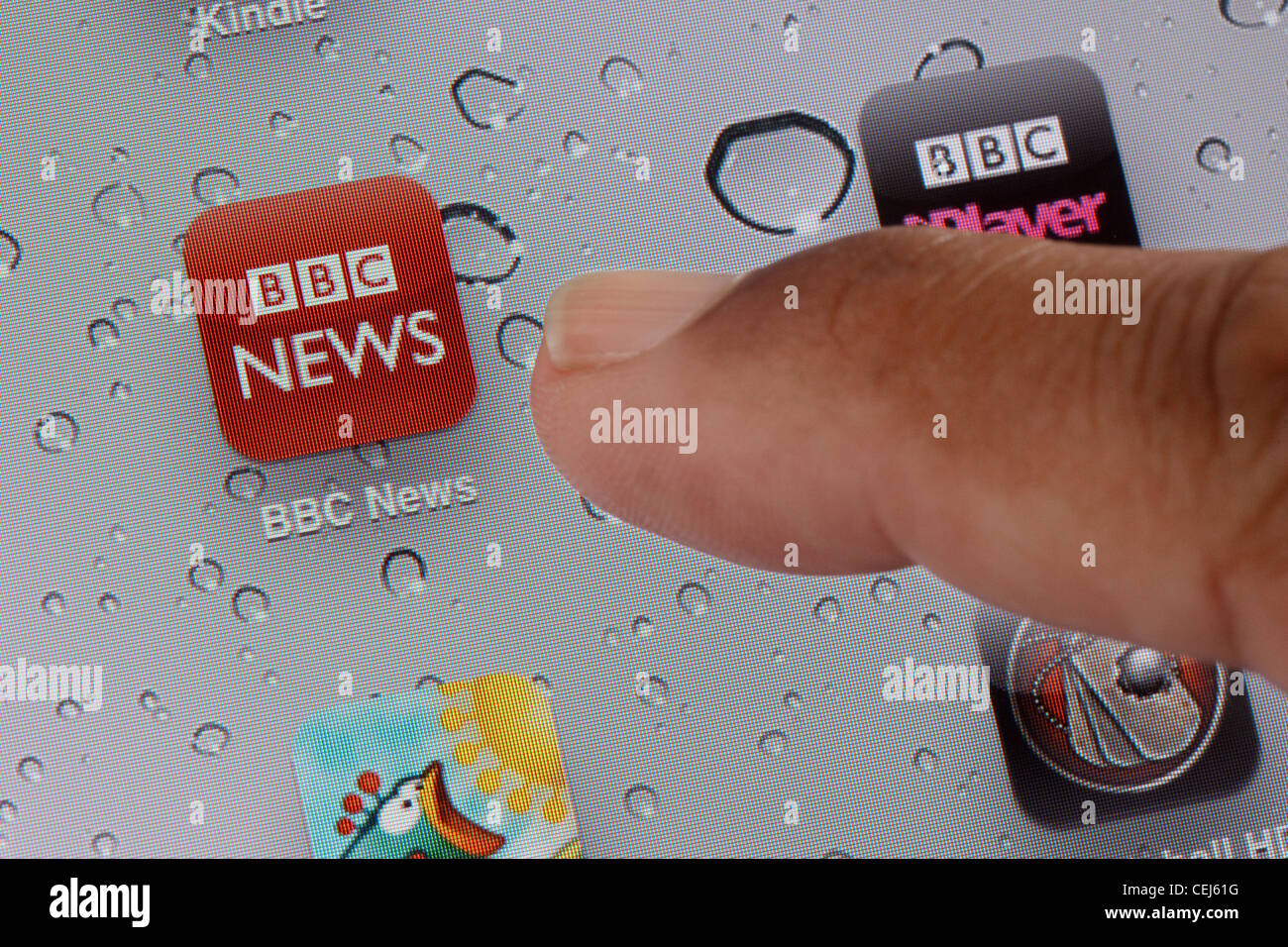 Close up of icon for the BBC News app on an iPad - Stock Image