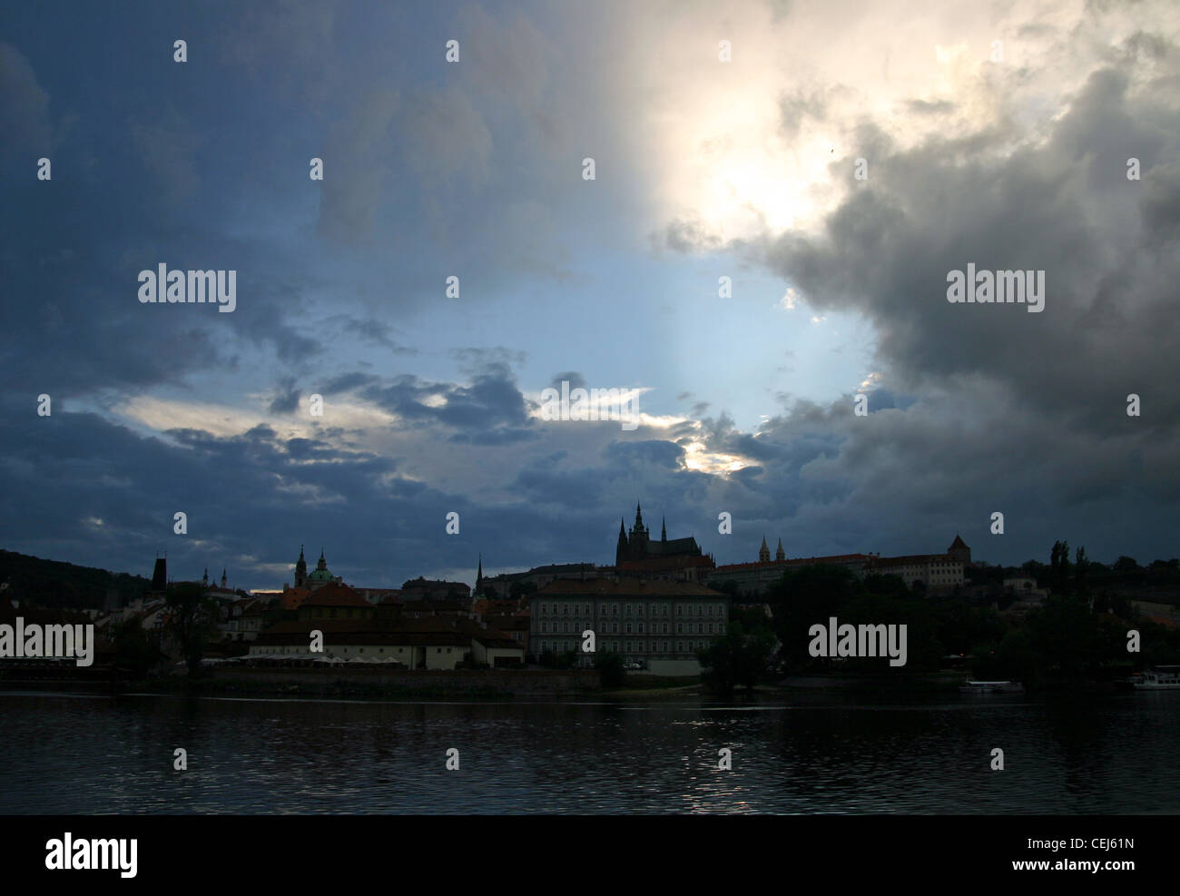 Prague Castle at dusk with the Vltava river in front. Stock Photo