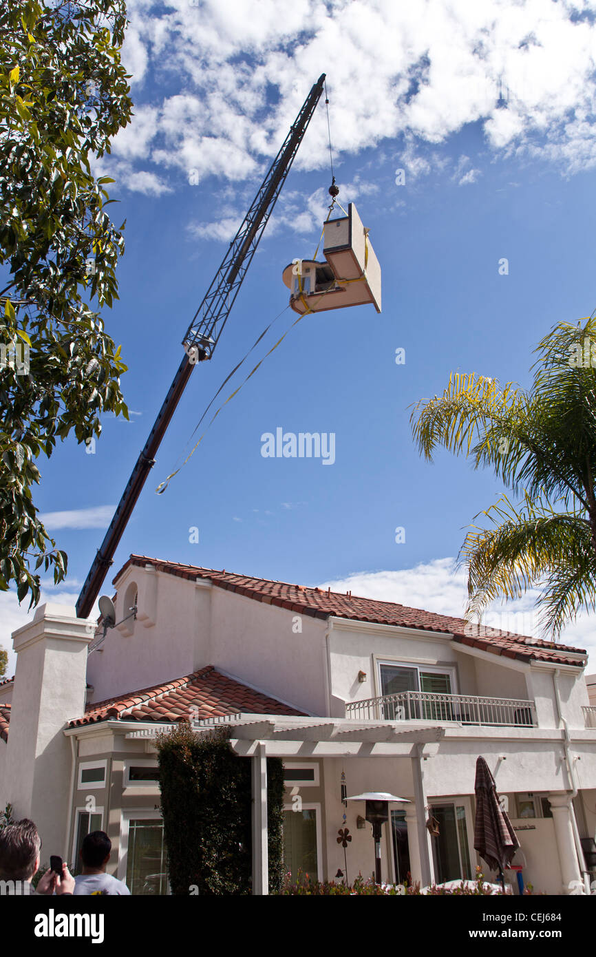 Crane lifting BBQ/outdoor Kitchen into backyard of Southern Stock ...