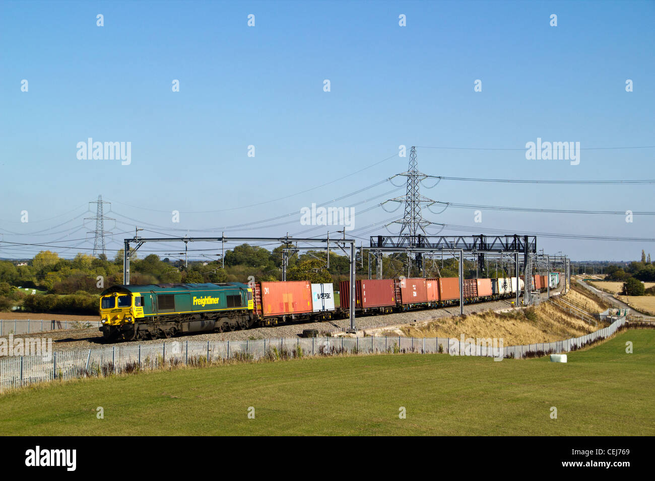 Freightliner class 66 and intermodal freight train, Lichfield, Staffordshire, England. - Stock Image